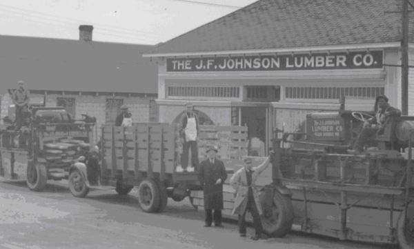 black and white photo of early JL days, truck being loaded