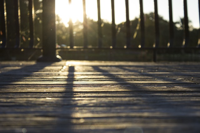 sun reflecting on a wood deck