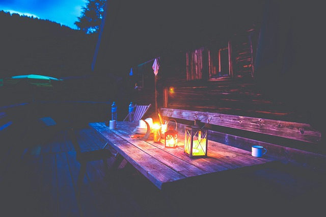 Candle-lit outdoor dining table